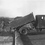 Lorry unloading clay at East Golds siding, built 1938