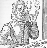 Woodcut of an Elizabethan smoking a clay tobacco pipe